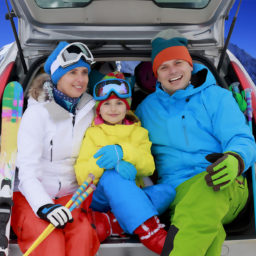 Winter, ski, journey - family with ski equipment ready for travel to ski resort